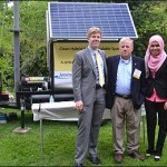 Seniors Nicholas Augspurger and Asma Mohd Sidik with JetStream's Steve Cornelius with a working prototype of a portable wind, solar and auxiliary gas generator energy system.