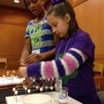 At the civil engineering station, girls built bridges using toothpicks and marshmallows. (Heidi Hall/Vanderbilt University)