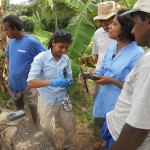 Thushara Gunda, second from left, performing water tests in Sri Lanka. (Submitted photo)