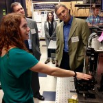 Biomedical engineering graduate student Kristin Poole demonstrates her work for a Board of Visitors tour.