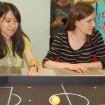 Undergraduates and Jianing Liu (CE'16) and Ashley Peck (ME'17) are helping design the robot kits. A visit by Adventure Science Center campers helped them see how young students would interact with the kits. (Heidi Hall/Vanderbilt University)
