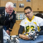 Jonathan Marrufo, senior and Engineering 2 student at the Chicago Military Academy - Bronzeville, shows a robot he programmed for class to Col. Eugene J. LeBoeuf. (U.S. Army photo by Sgt. 1st Class Michel Sauret)